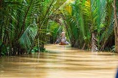 Vietnamese boatman in the Mekong Delta Stock Photos