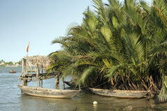Vietnamese boats, Vietnam. Boats, as a means of transport and fishing tool Stock Photos