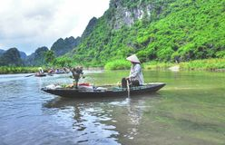 Vietnamese Boatwoman Trader. A photo of a woman peddling her wares on a boat in Tam Coc, Vietnam Stock Photography