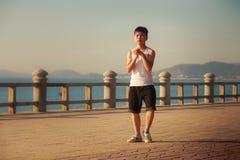 Vietnamese boy bends downward on embankment at dawn Stock Photo