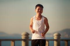 Vietnamese boy runs on embankment at dawn Stock Image