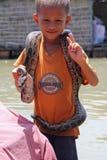 Vietnamese Boy Showing A Snake Royalty Free Stock Photos