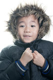 Vietnamese boy with winter jacket hood on Royalty Free Stock Image