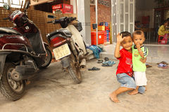 Vietnamese boys posing with bike Royalty Free Stock Image