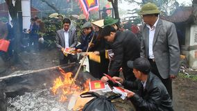 Vietnamese burning paper money for the dead stock footage