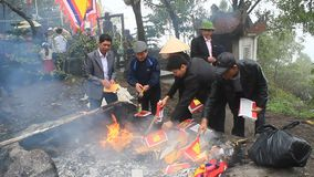 Vietnamese burning paper money for the dead stock video footage
