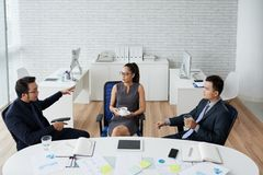 Important meeting. Vietnamese business people having important meeting in office royalty free stock images
