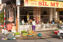 Vietnamese butchery and fruit and vegetable vendor on footpath i Stock Images