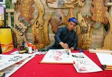 Vietnamese calligrapher Stock Images