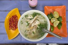 Vietnamese chicken noodle soup called pho, with green onion, bean sprouts and chili.  Stock Images