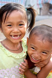 Vietnamese Children. Two Vietnamese children laughing with one another in the Mekong Delta Stock Image