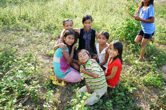 Vietnamese children in country. KHANH HOA, VIET NAM- FEB 16: Unidentified Vietnamese children in country, kids have pretty, lovely  face sitting on meadow and Stock Images