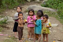 Vietnamese Children Playing. SAPA, VIETNAM- NOVEMBER 21: Six unidentified Vietnamese children play and eat in Sapa, Vietnam on November 21, 2010. Population in stock photography