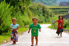 Vietnamese children running with joy. Sapa village Stock Photo