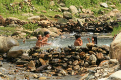 Vietnamese children swimming. Vietnamese minority children swimming on a pool created from a spring and natural stone in Mu Cang Chai district, Yen Bai province Stock Photography