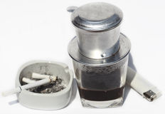 Vietnamese cofe and cigarette with ashtray Royalty Free Stock Images