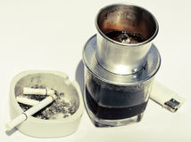 Vietnamese cofe and cigarette with ashtray Royalty Free Stock Photography