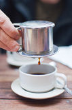 Vietnamese coffee brewing Stock Image