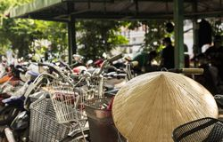 Vietnamese conical hat and bicycles, Vietnam. Stock Photos