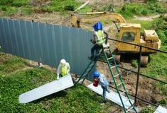 Vietnamese construction worker working Stock Photos