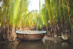 Traditional Fishing Boat the Coracle. The Vietnamese coracle, a traditional fishing boat is small, round and lightweight and easy to maneuver with one arm as the Royalty Free Stock Image