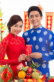 Vietnamese couple with greeting card Stock Photo