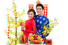 Vietnamese couple at the holiday table Royalty Free Stock Images