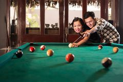 Vietnamese couple playing pool Royalty Free Stock Images