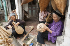 Vietnamese craftsmen making bamboo handicraft products Stock Images