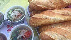 Vietnamese Cuisine - Pork Curry with French Bread. (Vietnamese: Banh mi xiu mai stock video