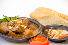 Vietnamese Cuisine - Pork Curry with French Bread. (Thit Heo Kho stock images