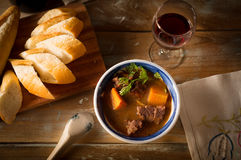 Vietnamese cuising beef stew with bread and red wine Stock Image