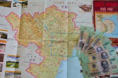 Vietnamese currency banknotes. Vietnamese banknotes on the map of Vietnam Royalty Free Stock Photos