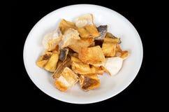Vietnamese deep fried dried Pangasius kunyit fish stock photo