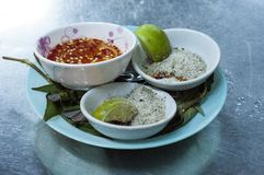 Vietnamese dipping sauces on a metallic table royalty free stock images