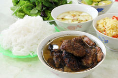 Vietnamese Dish Bun Cha. Bun cha, a Vietnamese dish of grilled pork and rice noodles served with fresh herbs and dipping sauce royalty free stock image