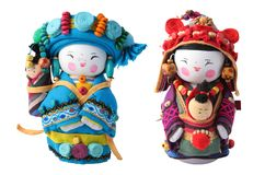 Vietnamese dolls with babies, isolated on white. Image of two dolls representing two Vietnamese women carrying babies, isolated on a white background. Clipping Stock Images