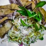 Vietnamese duck salad. Banana bud salad with duck. A traditional dish in Mekong delta, South of Vietnam stock photo