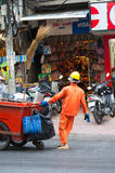 Vietnamese dustman at work Royalty Free Stock Photo