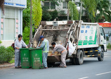 Vietnamese dustmen at work Royalty Free Stock Photography