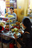 Vietnamese eat lunch at the central market Stock Image