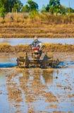 Vietnamese farmer prepares drowned field to sow rice Stock Photos