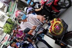 Vietnamese father buy lantern for kid. HO CHI MINH CITY, VIET NAM- SEPT 13, 2016: Vietnamese father visit lantern street to buy lanterns for kid on mid autumn Royalty Free Stock Photo