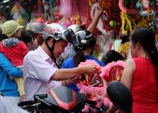 Vietnamese father buy lantern for kid. HO CHI MINH CITY, VIET NAM- SEPT 13, 2016: Vietnamese father visit lantern street to buy lanterns for kid on mid autumn Stock Photos