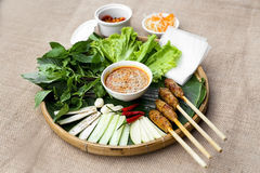 Vietnamese fermented pork roll or nem Hue with lettuce, herbs an royalty free stock photography