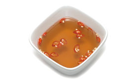 Vietnamese fish sauce bowl red chili Stock Photos