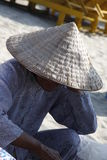 Vietnamese Fisherman. Fisherman relaxing in Vietnam with leaf hat Royalty Free Stock Photography