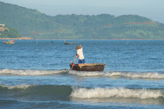 Vietnamese fisherman sails on the boat to check fishing nets Royalty Free Stock Images