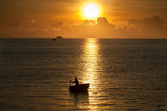Vietnamese fisherman. Scene with vietnamese fisherman at traditional boat on the sunrise Stock Image