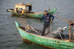 Vietnamese fisherman withdrawing net Royalty Free Stock Images